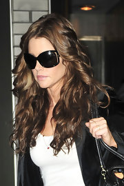 Denise Richards traveled in style while leaving the New York TV Studios. She showed off her long brunette curls.
