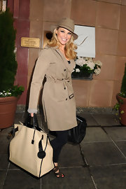 Christie Brinkley carried an oversize cream tote with black leather trim out and about in NYC.