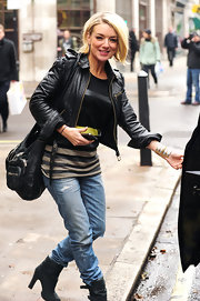 Sheridan sports a leather zip up in London.