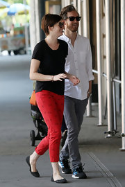 Anne sported a pair of bright red capri pants with cherry prints on them while out on a stroll.