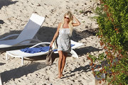 Victoria Silvstedt covered up at the beach in a heathered day dress.