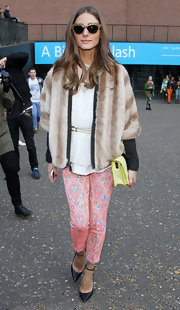Olivia Palermo brightened up her look with paisley cigarette pants at the Unique by Topshop runway show in London.