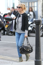 Sienna Miller filmed a commercial wearing this black tasseled cardigan with ribbon fastening.