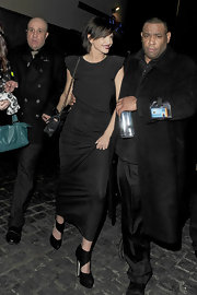 Sarah Harding teamed her black maxi dress with matching platform cutout booties.
