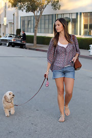 Minka dons a sheer floral print blouse while taking her pup on a walk.