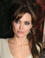 Angelina Jolie rocked a sot smoky eye to the premiere of 'The Tourist.' It was a nice touch when paired with her half up 'do.