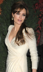 Angelina Jolie paired her long brunette locks with dangling gemstone earrings in a soft green shade.
