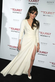 Angelina Jolie did winter white right in white Ferragamo pumps, which she donned with a floor length angora Versace gown.