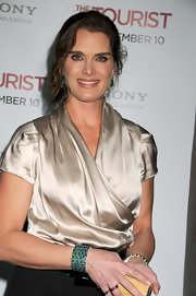 Brook Shields paired her champagne blouse with an emerald green cuff bracelet.