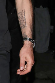 David was spotted at Las Palmas lounge where we caught a glimpse of his arm tattoo.