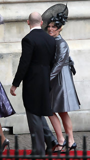 Zara Phillips attended the Royal Wedding wearing a fancy black hat and a shimmery gray coat dress.