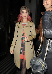 Katy Perry stepped out in a classic trench coat with leather accents for a dinner out in Mayfair.