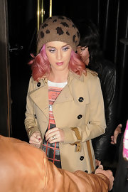 Katy Perry donned a leopard print beret with her trench coat while out in Mayfair.