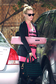 January Jones kept her yoga attire on-trend with a striped navy-and-green canvas tote from the Spring 2011 collection.