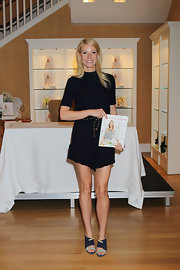 Gwyneth Paltrow wore stunning navy Stingray strappy sandals with lucite heels and turquoise straps over the toes to a book signing.