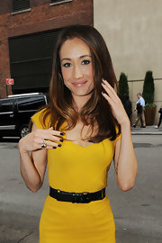 Maggie Q contrasted her bright dress with black nail polish when she attended CW Network's Upfront event.