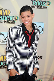 Roshon showed off his striped blazer which he paired with a satin red tie.