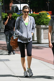 Jessica Biel showed off her sporty side while hitting the NYC streets. She paired her look with a tan fringe shoulder bag.