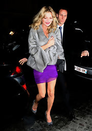 Kate Moss looked dined out in ladylike gray cap toe pumps.