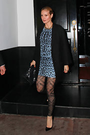 Super Mom Heidi Klum is seen coming out of Beso after filming for Project Runway. Her blue leopard dress and printed tights were a little on the wild side. She added a patent leather printed clutch to match her patent pumps.