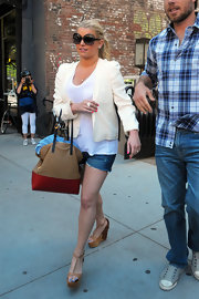 Jessica Simpson rocked her signature look in these over-sized sunglasses.
