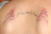 Kelly Osbourne Wings Tattoo