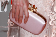 Natalia Vodianova Clutches