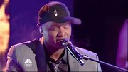 Javier Colon dressed down his suit and tie with a black initialed baseball cap.