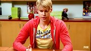Chord Overstreet continued to show the Justin Bieber side of his style in this tight red zip-up hoodie.