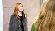 Kaylee Defer looks like a NYC local in a wooly gray coat and black sweater dress.