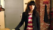 Zooey Deschanel kept her playful striped top professional with a tailored black blazer.
