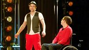 Chord Overstreet paired a dressy suit vest with red cargo pants for a blend of casual and dressy.