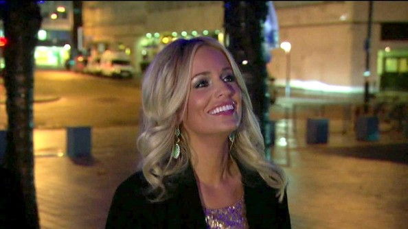 Emily Maynard upped the sparkle of her London style with dangling mint earrings.