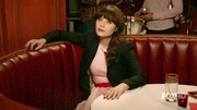 Wearing one of her new favorite labels, Deschanel's character dressed up in a belted pink frock, which she balanced with her beloved boyfriend-inspired blazer.
