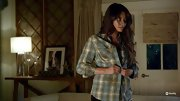 Sure it may be covered in cemetery dirt (yuck), but Shay Mitchell still looks pretty darn good in this plaid flannel shirt.