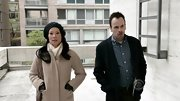 Lucy Liu bundled up on 'Elementary' in a chic taupe high collar coat.
