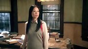 Lucy Liu embraced the color-block trend with this fun coral-accented sweater.