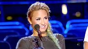 Demi Lovato wore her blue and green streaked locks in a fishtail side braid on 'The X Factor.'