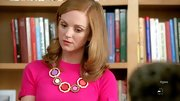 Jayma Mays played up the fuchsia shade of her sweater with a retro '70s-inspired geometric necklace in varying pink and purple hues.