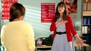 Zooey Deschanel paired her powder blue frock with this vibrant red cardigan on 'New Girl.'