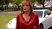 Linda Gray was ravishing in red on 'Dallas' in a sophisticated cowl neck dress.