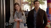 Julie Gonzalo's print scarf picks up the coral shade of her top.