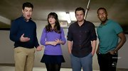 Zooey Deschanel sported a girlie purple crew neck sweater for an episode of 'New Girl.'