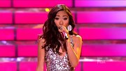 Jessica Sanchez full-bodied curls matched her sequined frock's disco vibe.