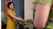 Elisabeth Moss chose a mustard-colored shift dress for her classic look on 'Mad Men.'