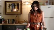 Lucy Hale looked ready for Halloween in a dotted orange button-down on 'Pretty Little Liars.'