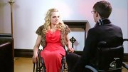 Ali Stroker looked glamorous in a shrug fur jacket and red dress on 'Glee.'