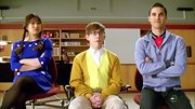 Jenna Ushkowitz opted for a funky blue dress with white buttons for her high school hallway look on 'Glee.'