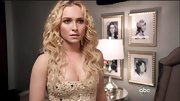 Hayden Panettiere matched the sparkle of her fitted dress with gold chandelier earrings.
