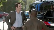 Work attire doesn't get much simpler than Ty Burrell's blue button-down and gray blazer.